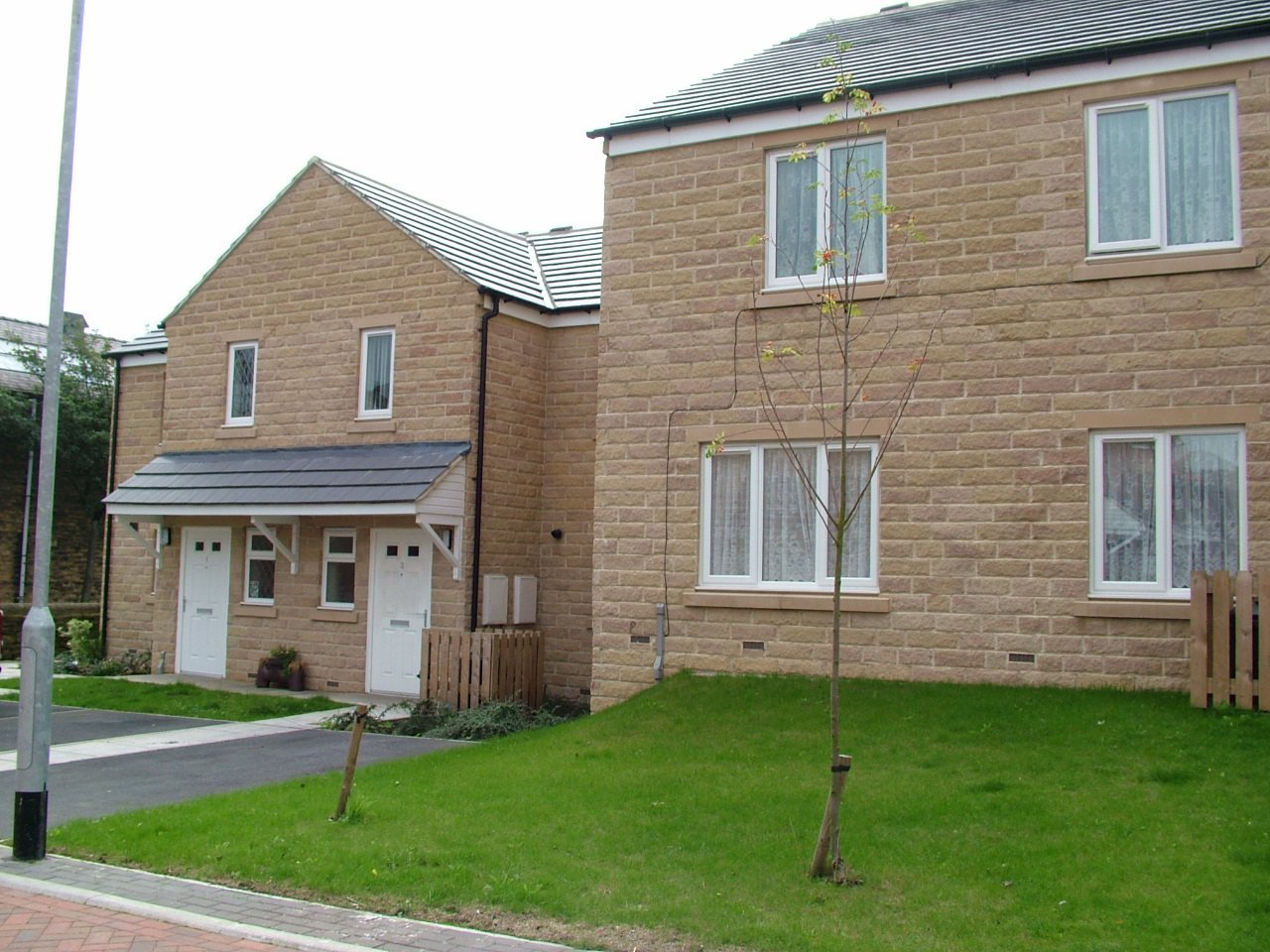 Detached houses built 'Labour Only' at West Holme Road for Southdale Homes